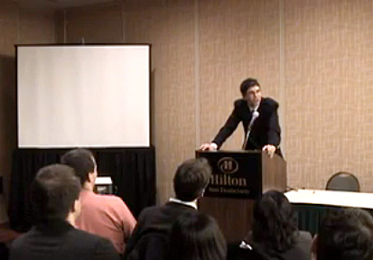Yoram speaking at a conference